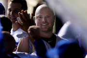 Jon Lester #34 of the Chicago Cubs celebrates with teammates after hitting a home run in the third inning against the Arizona Diamondbacks at Wrigley Field on August 1, 2017 in Chicago, Illinois.