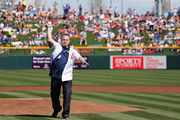 Mayor of the city of Mesa, Scott Smith throws out the first pitch before the spring training game between the Chicago Cubs and the Arizona Diamondbacks at Cubs Park on February 27, 2014 in Mesa, Arizona