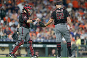 Alex Avila #5 of the Arizona Diamondbacks visits the mound and hands the ball  to Zack Godley #52 in the third inning against the Houston Astros  at Minute Maid Park on September 15, 2018 in Houston, Texas.