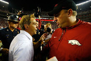 Head coach Nick Saban of the Alabama Crimson Tide shakes hands with head coach Bret Bielema of the Arkansas Razorbacks after their 27-14 win at Bryant-Denny Stadium on October 10, 2015 in Tuscaloosa, Alabama.