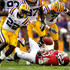 Ron Brooks Dennis Johnson Photos - Running back Dennis Johnson #33 of the Arkansas Razorbacks looses a fumble caused by cornerback Tyrann Mathieu #7 of the LSU Tigers and it is recovered by cornerback Ron Brooks #13 in the second quarter at Tiger Stadium on November 25, 2011 in Baton Rouge, Louisiana. - Arkansas v LSU