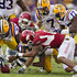 Ron Brooks Dennis Johnson Photos - Ron Brooks #13 and Karnell Hatcher #37 of the LSU Tigers recover a fumble by Dennis Johnson #33 of the Arkansas Razorbacks at Tiger Stadium on November 25, 2011 in Baton Rouge, Louisiana. - Arkansas v LSU
