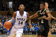 Rasheed Sulaimon #14 of the Duke Blue Devils drives against Mo Williams #2 of the Army Black Knights during a game at Cameron Indoor Stadium on November 30, 2014 in Durham, North Carolina. Duke defeated Army 93-73.