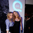 She strikes a pose with Heather Graham.