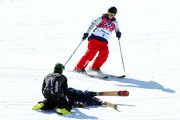 Keri Herman of the United States skis to James Woods of Great Britain after a fall by Woods during a Slopestyle official training session ahead of the the Sochi 2014 Winter Olympics at Rosa Khutor Extreme Park on February 7, 2014 in Sochi, Russia.