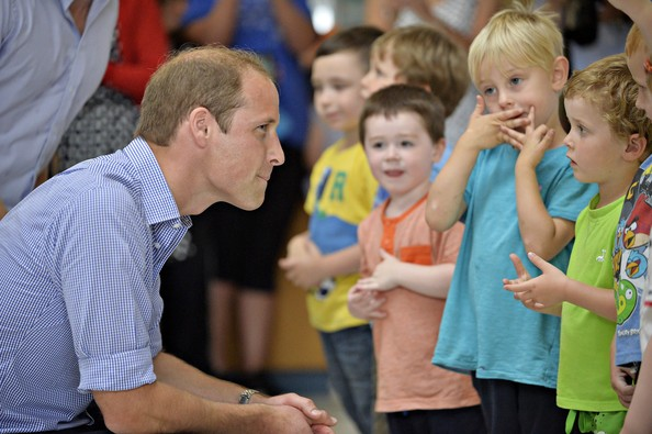 Prince William, Duke of Cambridge meets children from Bridgend nursery during a visit to the Coach Core project at Gorbals Leisure Centre on July 29, 2014 in Glasgow, Scotland.