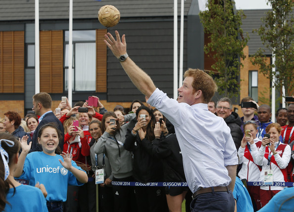 Prince Harry plays a game during a visit to the Commonwealth Games Village on July 29, 2014 in Glasgow, Scotland.