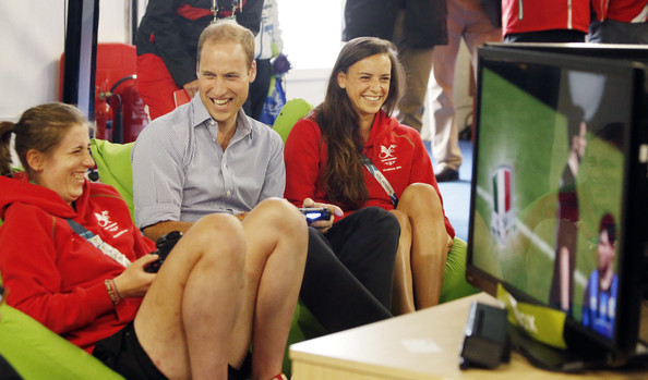 Prince William, Duke of Cambridge plays a computer game during a visit to the Commonwealth Games Village on July 29, 2014 in Glasgow, Scotland.