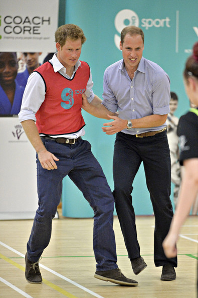Prince Harry and Prince William, Duke of Cambridge play 5 a side football during a visit to the Coach Core project at Gorbals Leisure Centre on July 29, 2014 in Glasgow, Scotland.