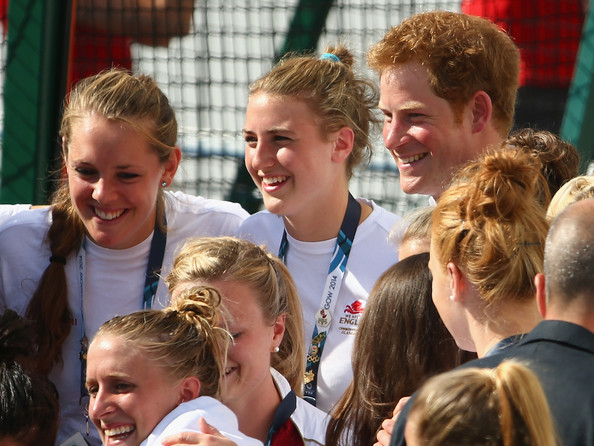 Prince Harry poses for a photograph with the England women's hockey team at Glasgow National Hockey Centre during day five of the Glasgow 2014 Commonwealth Games on July 28, 2014 in Glasgow, United Kingdom.