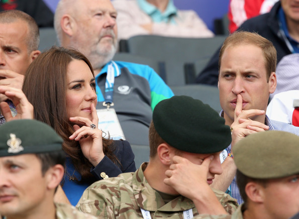 Catherine, Duchess of Cambridge and Prince William, Duke of Cambridge watch the athletics at Hampden Park as they attend day six of the Commonwealth Games on July 29, 2014 in Glasgow, Scotland.