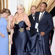 Rita Ora raised the roof while an assistant raised her dress(?)