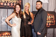 (L-R) Kelli Cashiola, Cassie McConnell and musician Chris Tyrrell attend the 2014 American Country Countdown Awards at Music City Center on December 15, 2014 in Nashville, Tennessee.