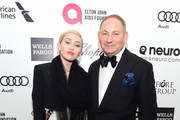 Miley Cyrus and John Demsey, Group President, The Estée Lauder Companies Inc., attend the 23rd Annual Elton John AIDS Foundation Academy Awards Viewing Party on February 22, 2015 in Los Angeles, California.