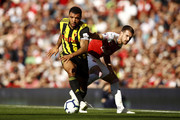 Troy Deeney of Watford takes the ball away from Aaron Ramsey (R) of Arsenal during the Premier League match between Arsenal FC and Watford FC at Emirates Stadium on September 29, 2018 in London, United Kingdom.