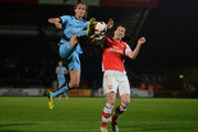 Jill Scott of Manchester City Ladies battles with Niamh Fahey of Arsenal Ladies during the Continental Cup Final between Arsenal Ladies and Manchester City Ladies at Adams Park on October 16, 2014 in High Wycombe, England.