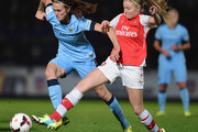 Jill Scott of Manchester City Ladies battles with Leah Williamson of Arsenal Ladies during the Continental Cup Final between Arsenal Ladies and Manchester City Ladies at Adams Park on October 16, 2014 in High Wycombe, England.