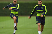 Lucas Perez (R) and Santi Cazorla (L) of Arsenal share a joke during an Arsenal training session ahead of the Champions League Group A match between Arsenal and Basel at London Colney on September 27, 2016 in St Albans, England.