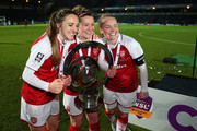 Lisa Evans, Emma Mitchell and Kim Little of Arsenal Women celebrate with the trophy after the WSL Continental Cup Final between Arsenal Women and Manchester City Ladies at Adams Park on March 14, 2018 in High Wycombe, England.