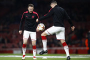Aaron Ramsey of Arsenal warms up for the UEFA Europa League Round of 16 Second Leg match between Arsenal and AC Milan at Emirates Stadium on March 15, 2018 in London, England.