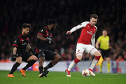 Aaron Ramsey of Arsenal keeps the ball from Franck Kessie and Suso of AC Milan during the UEFA Europa League Round of 16 Second Leg match between Arsenal and AC Milan at Emirates Stadium on March 15, 2018 in London, England.