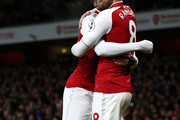 Aaron Ramsey of Arsenal celebrates after scoring his sides fifth goal with Alex Iwobi of Arsenal during the Premier League match between Arsenal and Everton at Emirates Stadium on February 3, 2018 in London, England.