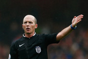 Referee Mike Dean gestures during the Emirates FA Cup fifth round match between Arsenal and Hull City at the Emirates Stadium on February 20, 2016 in London, England.