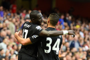 Mohamed Diame of Hull City celebrates with team-mate Hatem Ben Arfa after scoring their first goal during the Barclays Premier League match between Arsenal and Hull City at Emirates Stadium on October 18, 2014 in London, England.
