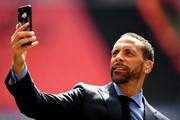BT Sport pundit Rio Ferdinand takes a photograph prior to the Emirates FA Cup Semi-Final match between Arsenal and Manchester City at Wembley Stadium on April 23, 2017 in London, England.