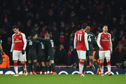 Henrikh Mkhitaryan, Mesut Ozil and Aaron Ramsey of Arsenal are dejected after the 2nd Man City goal during the Premier League match between Arsenal and Manchester City at Emirates Stadium on March 1, 2018 in London, England.