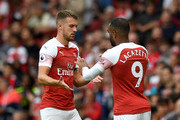Aaron Ramsey is substituted for Alexandre Lacazette of Arsenal during the Premier League match between Arsenal FC and Manchester City at Emirates Stadium on August 12, 2018 in London, United Kingdom.