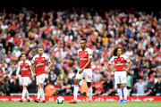 Pierre-Emerick Aubameyang and Aaron Ramsey of Arsenal look dejected after Manchester City's first goal during the Premier League match between Arsenal FC and Manchester City at Emirates Stadium on August 12, 2018 in London, United Kingdom.