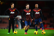 (L-R) Adnan Januzaj, Juan Mata and Patrice Evra of Manchester United warm up before the Barclays Premier League match between Arsenal and Manchester United at the Emirates Stadium on February 12, 2014 in London, England.