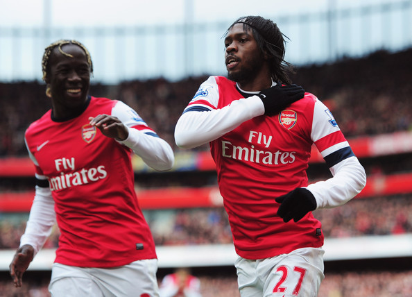 Gervinho of Arsenal (27) celebrates with Bacary Sagna as he scores their first goal during the Barclays Premier League match between Arsenal and Reading at Emirates Stadium on March 30, 2013 in London, England.