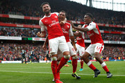 Santi Cazorla of Arsenal celebrates scoring his sides second goal with his team mates during the Premier League match between Arsenal and Southampton at Emirates Stadium on September 10, 2016 in London, England.
