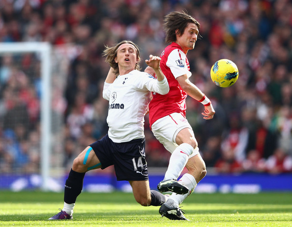 Tomas Rosicky of Arsenal is challenged by Luka Modric of <a href=