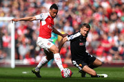 Francis Coquelin of Arsenal and Almen Abdi of Watford compete for the ball during the Barclays Premier League match between Arsenal and Watford at Emirates Stadium on April 2, 2016 in London, England.