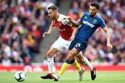 Aaron Ramsey of Arsenal and Ryan Fredericks of West Ham United battle for the ball during the Premier League match between Arsenal FC and West Ham United at Emirates Stadium on August 25, 2018 in London, United Kingdom.