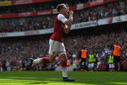 Aaron Ramsey of Arsenal celebrates scoring his side's second goal during the Premier League match between Arsenal and West Ham United at Emirates Stadium on April 22, 2018 in London, England.