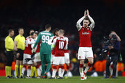 Aaron Ramsey of Arsenal applauds the fans after victory in the UEFA Europa League Round of 16 Second Leg match between Arsenal and AC Milan at Emirates Stadium on March 15, 2018 in London, England.
