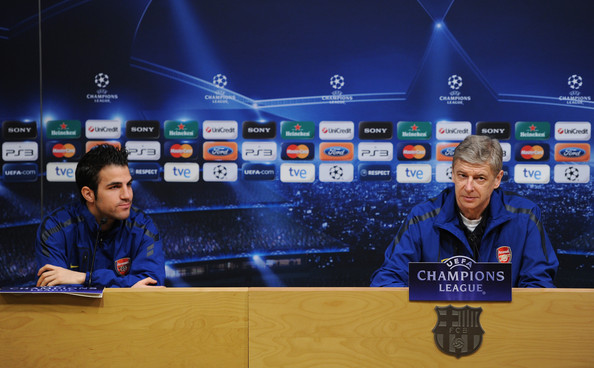 Arsene Wenger Arsene Wenger (R), Manager of Arsenal sits besides player Cesc Fabregas during a press conference ahead of their UEFA Champions League round of 16 second leg match against Barcelona at the Camp Nou stadium on March 7, 2011 in Barcelona, Spain.