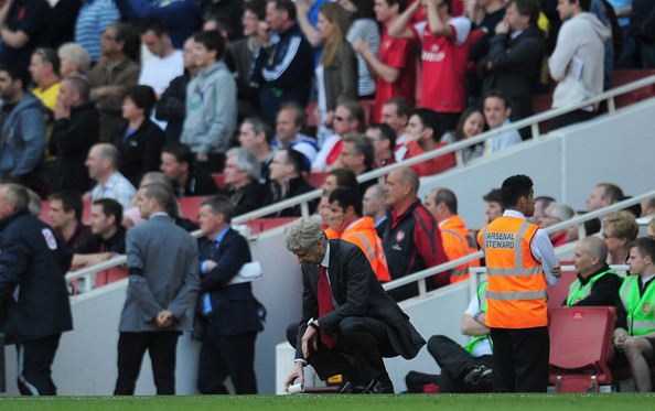 Arsene Wenger Dejected Arsenal manager Arsene Wenger after referee Andre Marriner awards Liverpool a penalty kick during the Barclays Premier League match between Arsenal and Liverpool at the Emirates Stadium on April 17, 2011 in London, England.