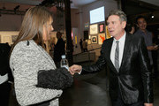 The Art of Elysium founder Jennifer Howell (L) and Eugene Sadovoy attend The Art Of Elysium's 7th Annual Pieces Of Heaven at Siren Studios on February 26, 2014 in Hollywood, California.