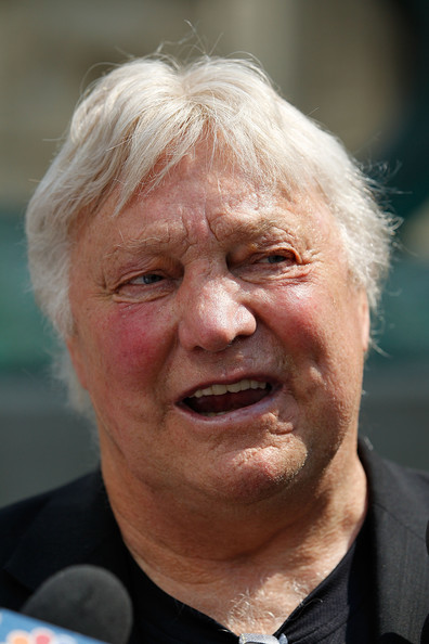 Bobby Hull Former Chicago Blackhawks star and Hall of Famer Bobby Hull meets with reporters in front of a lion sculpture sporting a Blackhawks helmet in celebration of the Blackhawks appearence in the Stanley Cup Finals against the Philadelphia Fylers at the Art Institue of Chicago on May 26, 2010 in Chicago, Illinois. The lion sculptures, by artist Edward L. Kemeys, were installed at the Michigan Avenue entrance to the museum in 1894.