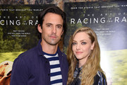 """Milo Ventimiglia and Amanda Seyfried attend """"The Art Of Racing In The Rain"""" New York Premiere at the Whitby Hotel on August 05, 2019 in New York City."""