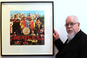 Artist Peter Blake poses for a photograph besides a copy of The Beatles Sgt Pepper LP album cover that he designed in 1967 as he reopens the Holburne Museum on May 12, 2011 in Bath, England. The new museum's first exhibition  - which opens to the public on Saturday - is Peter Blake: A Museum for Myself and will for the first time show extraordinary objects from Peter Blake's own collection together with a number of important works by the artist himself. The new Holburne Museum includes the restoration of its Grade I listed building and the construction of a striking new extension by Eric Parry Architects. The Museum houses a collection of fine and decorative arts built around the remarkable art collection of Sir William  Holburne, first assembled in 19th century Bath, including works by  Gainsborough, Zoffany and Turner.