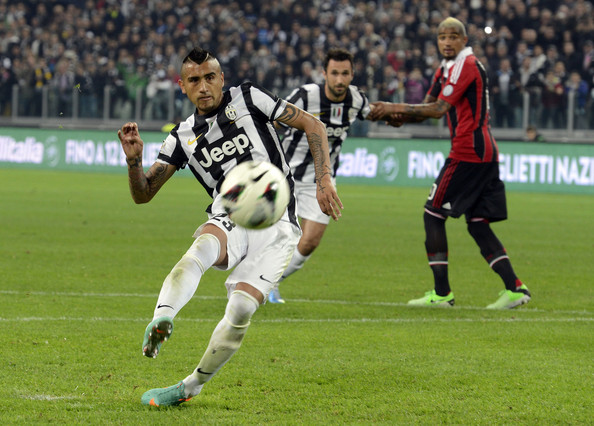 Arturo Vidal Arturo Vidal of Juventus FC scores the first goal during the Serie A match Juventus FC v AC Milan at Juventus Arena on April 21, 2013 in Turin, Italy.