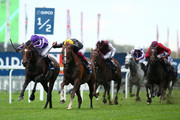 Donnacha O'Brien rides Kew Gardens (L) to beat Frankie Dettori on Stradivarius in The QIPCO British Champions Long Distance Cup during the QIPCO British Champions Day at Ascot Racecourse on October 19, 2019 in Ascot, England.