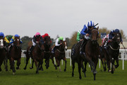Paul Hanagan riding Muhaarar (R, blue/white cap) win The Qipco British Champions Sprint Stakes at Ascot racecourse on October 17, 2015 in Ascot, England.