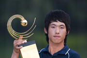 Chang-Won Han of South Korea poses with the trophy after winning the Asian Amateur Championship at the Mission Hills Golf Club on November 1, 2009 in Shenzhen, Guangdong, China.